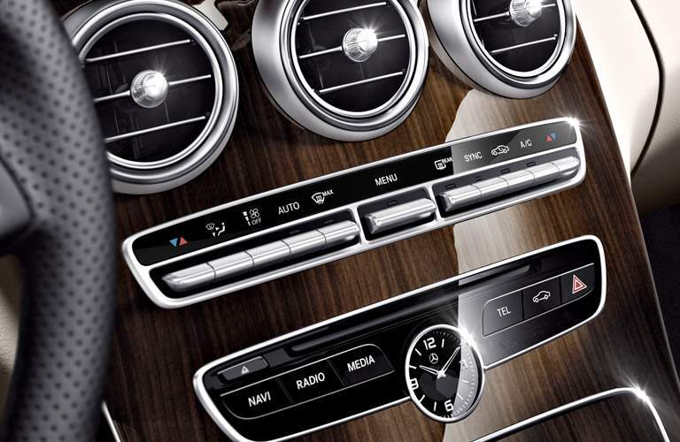 vents and infotainment toggles in the 2017 Mercedes-Benz C-Class with wood-like veneer