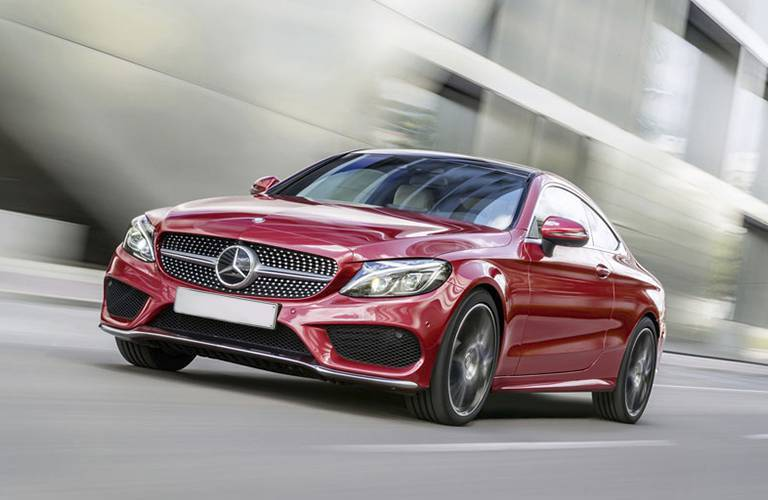 red 2017 Mercedes-Benz C-Class on the road