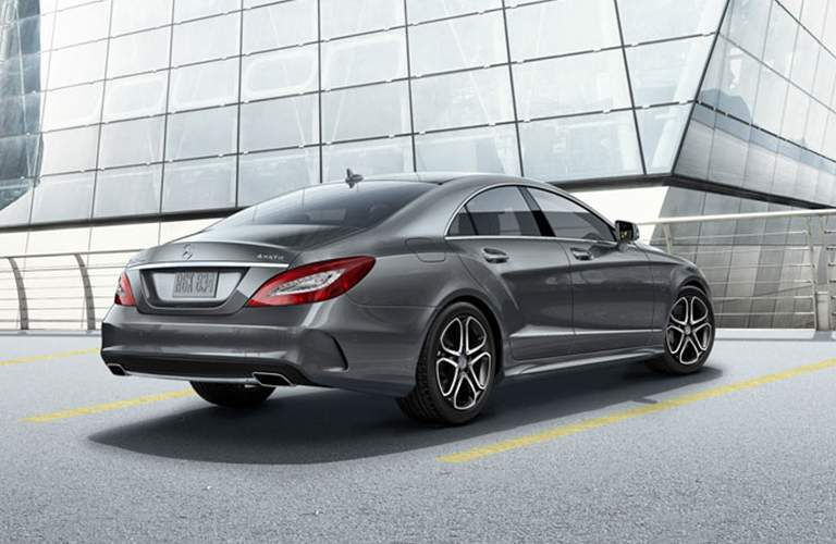 rear and side view of the 2018 Mercedes-Benz CLS parked by a glass building