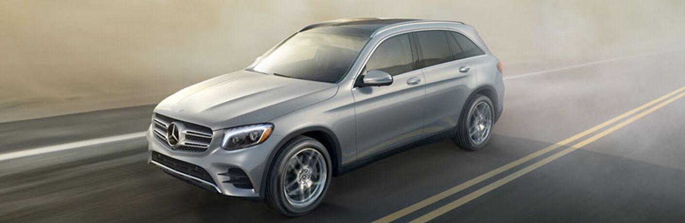 2018 Mercedes-Benz GLC 300 seen from the side, driving on the road, silver
