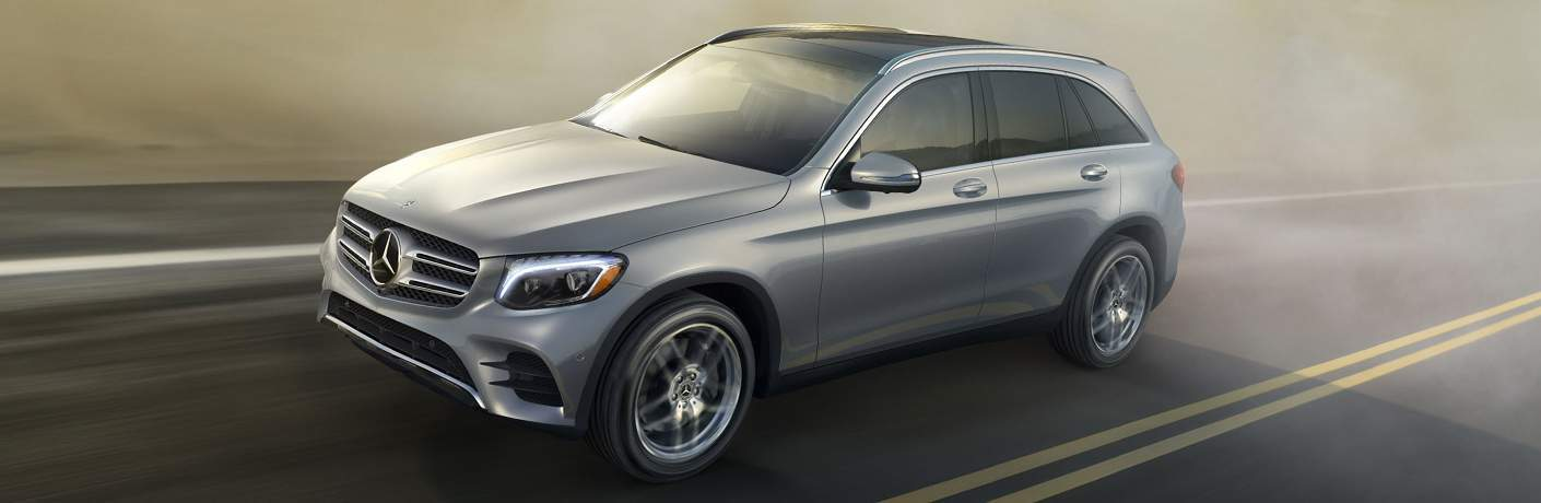 2018 Mercedes-Benz GLC SUV driving on the road through slight fog