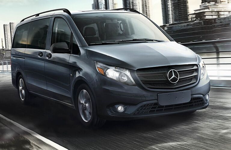 front and side view of a 2018 Mercedes-Benz Metris driving through the city