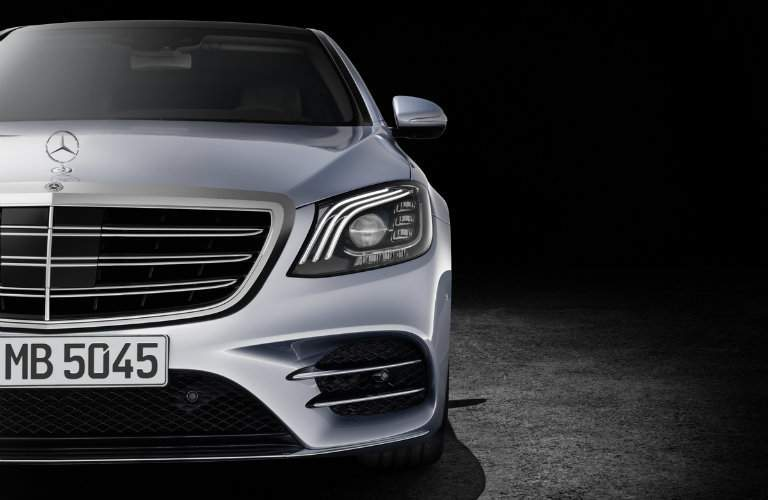front grille close-up of the 2018 Mercedes-Benz S-Class on a black background