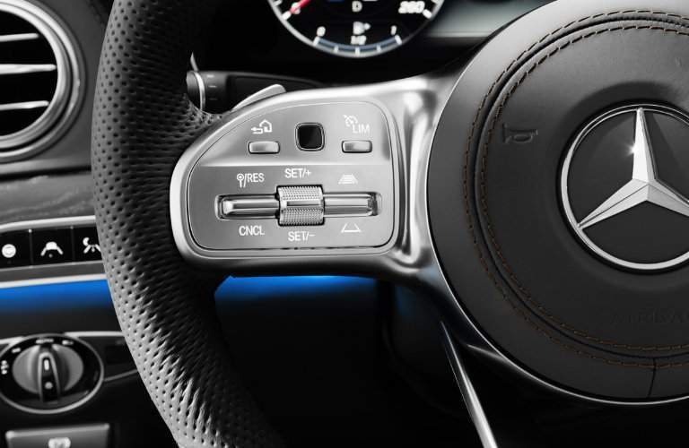 close-up on the steering wheel controls of the 2018 Mercedes-Benz S-Class