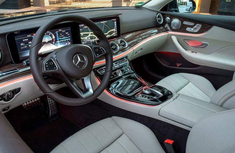 front seat and vast display screen dashboard of the 2018 Mercedes-Benz E-Class Coupe