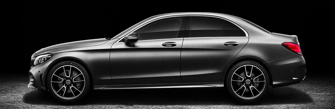 side view of the 2019 Mercedes-Benz C-Class sedan with a black background