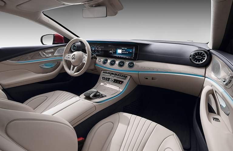 front seats, blue lighting, and dashboard of the 2019 Mercedes-Benz CLS