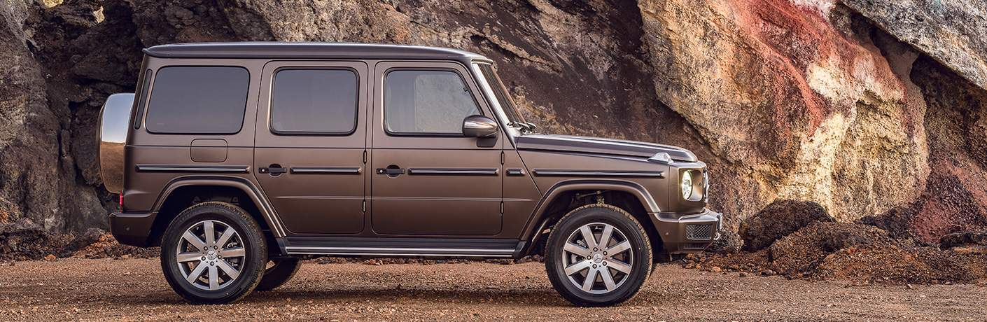 side view of a brown 2019 Mercedes-Benz G-Class with rocks in the background
