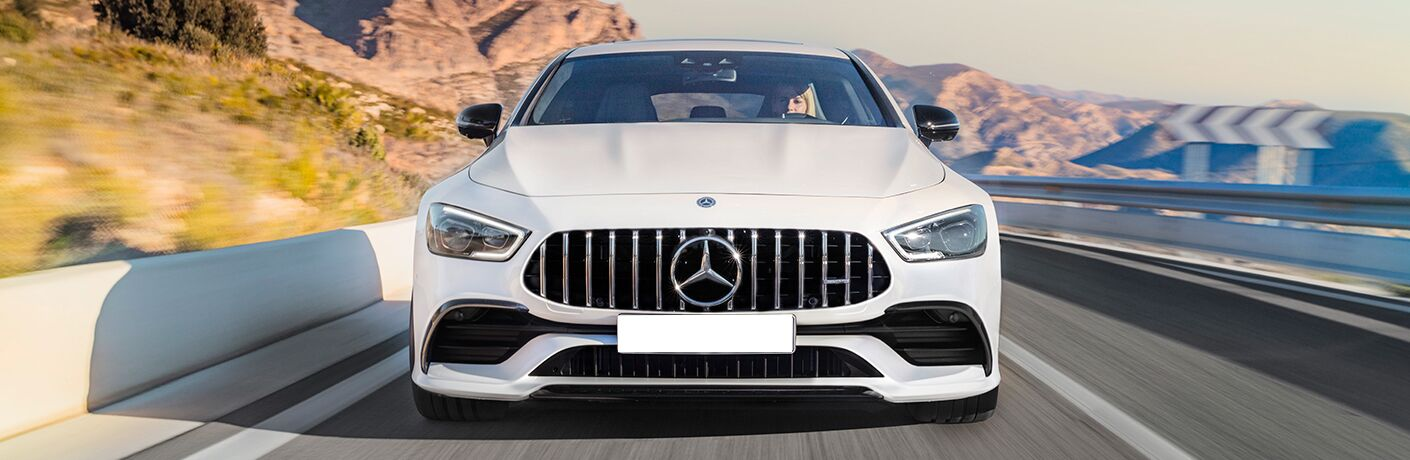 front view of a white 2019 Mercedes-AMG® GT Four-Door Coupe