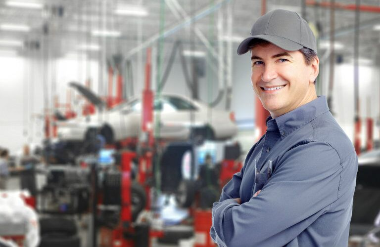 confident service technician ready to get your car back on the road