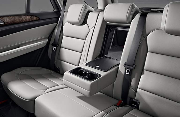 second row seating in the 2018 Mercedes-Benz GLE with center armrest and cup holders folded down