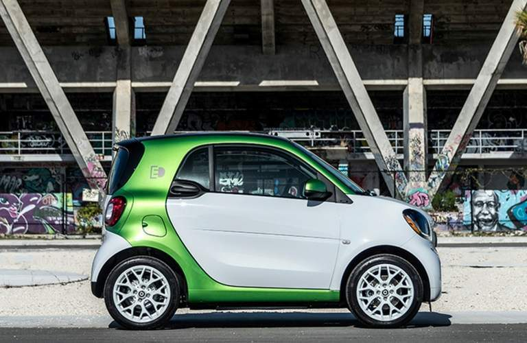 2018 smart fortwo electric drive Passion Coupe parked in an urban area with graffiti in the background