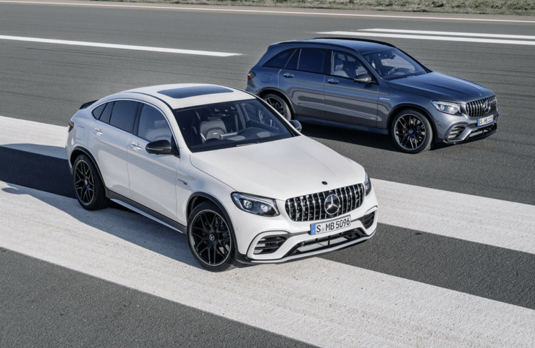 2018 Mercedes-AMG GLE63 Coupe next to GLC63 SUV