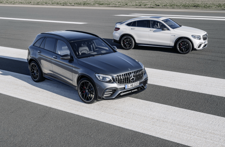 2018 Mercedes-AMG GLC 63 SUV exterior front two models