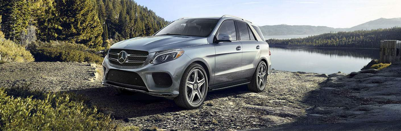 full view of the 2018 Mercedes-Benz GLE SUV parked in a forest by a lake