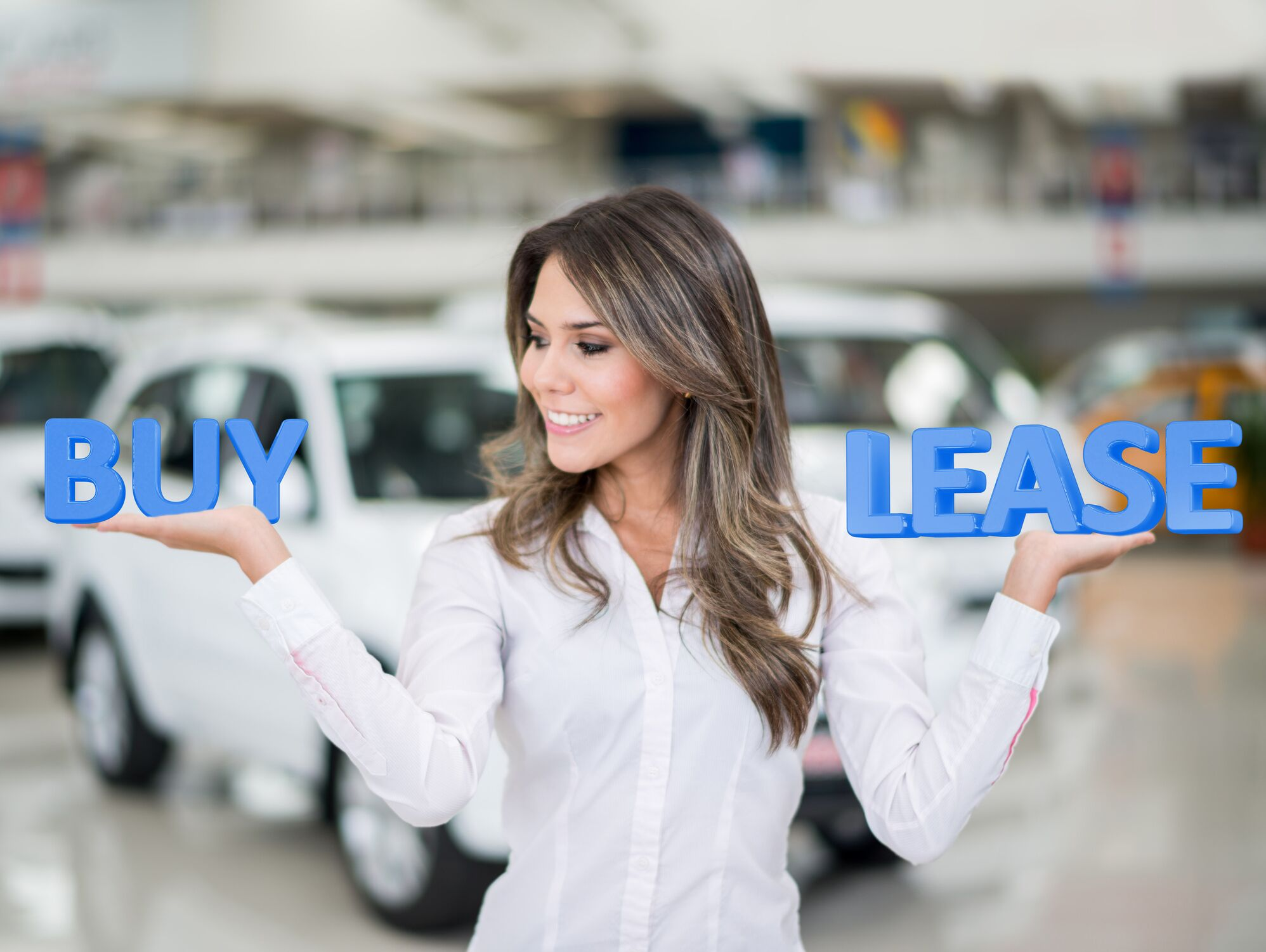 Woman Holding Up Words BUY and LEASE
