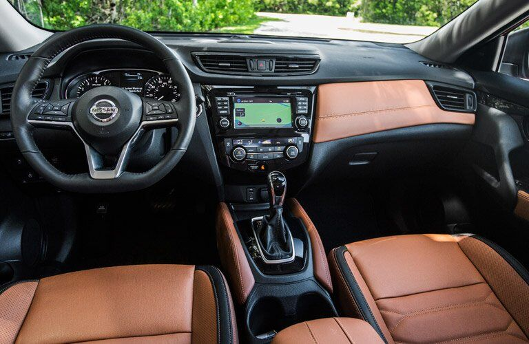 2018 nissan rogue interior with infotainment and steering wheel center frame