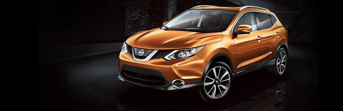 orange 2017 Nissan Rogue Sport with dark background