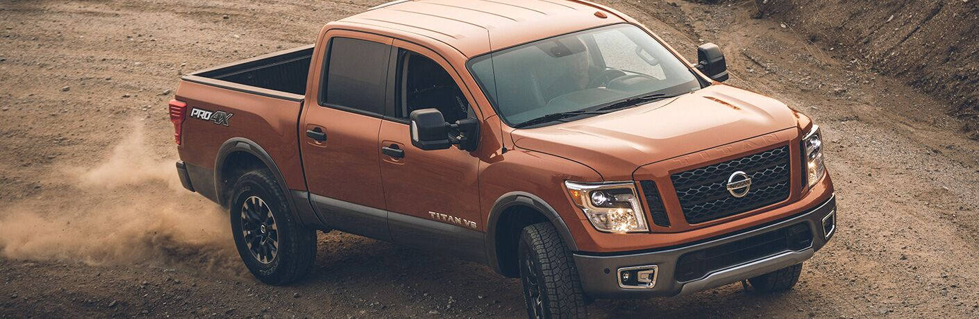 2019 Nissan TITAN® driving on an off-road trail