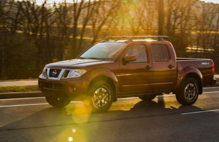 2020 Nissan Frontier driving on a road
