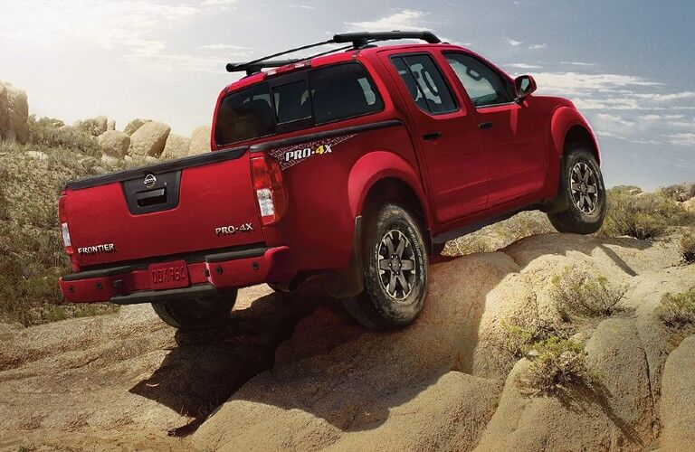 2021 Nissan Frontier driving on rocks