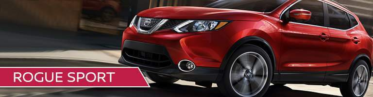 red Nissan Rogue Sport with red title