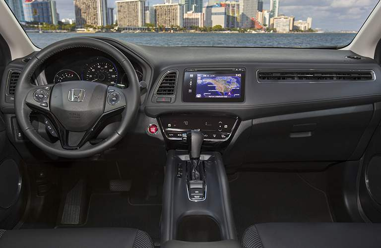 2018 Honda HR-V steering wheel, dashboard, cityscape in background