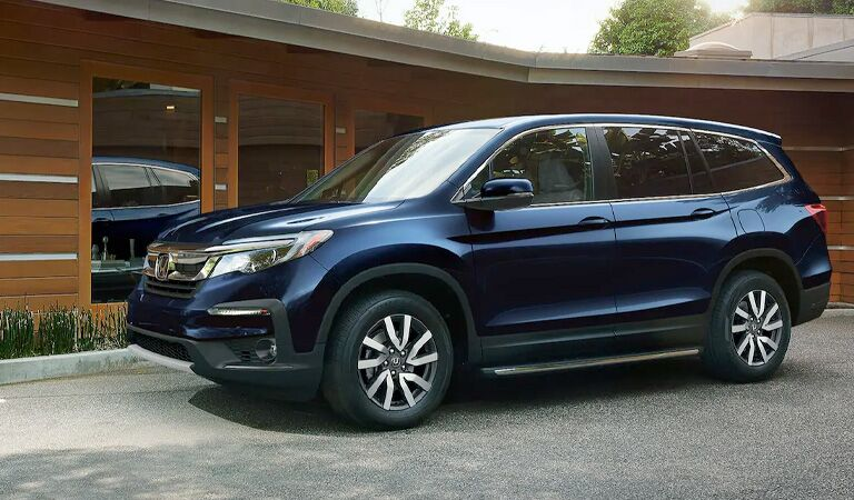 2016 Honda Pilot SUV parked in front of a lake