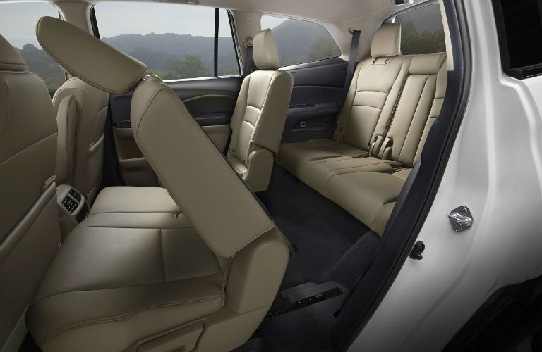 seating in 2019 honda pilot with second and third rows shown