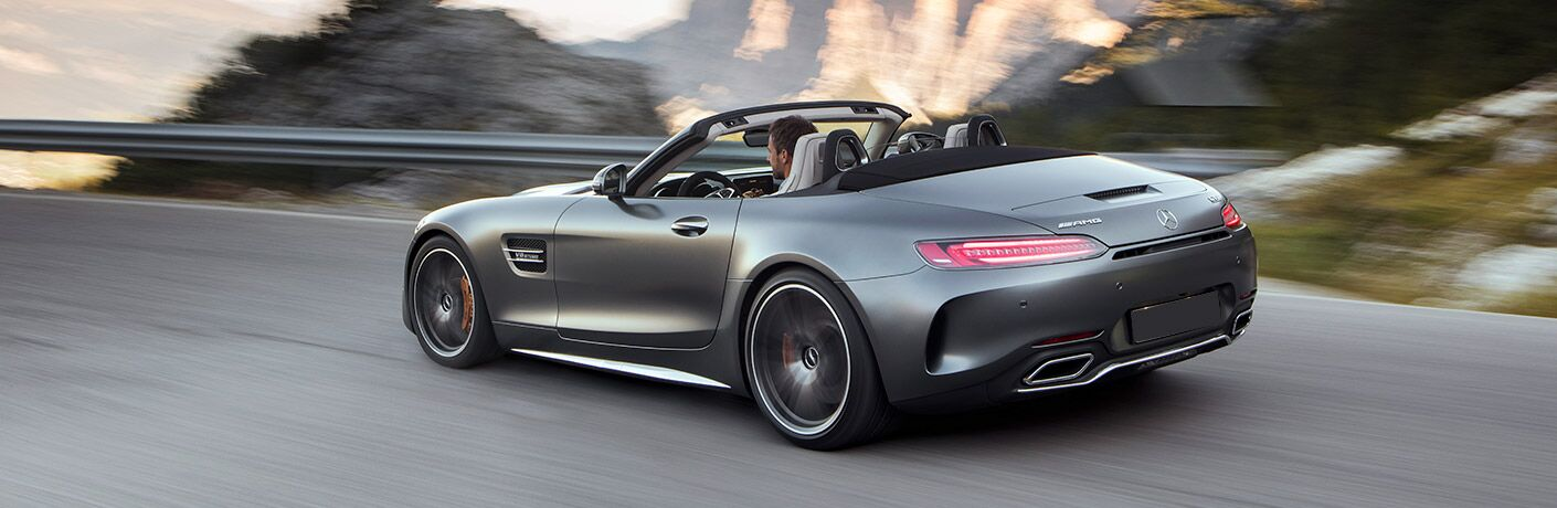 Driver side exterior view of a gray 2018 Mercedes-AMG GT Roadster