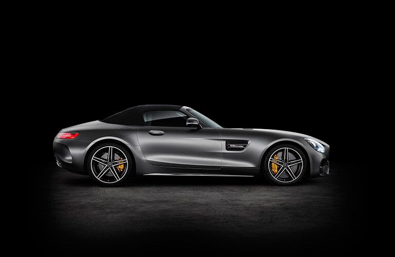 Passenger side exterior view of a gray 2018 Mercedes-AMG GT Roadster