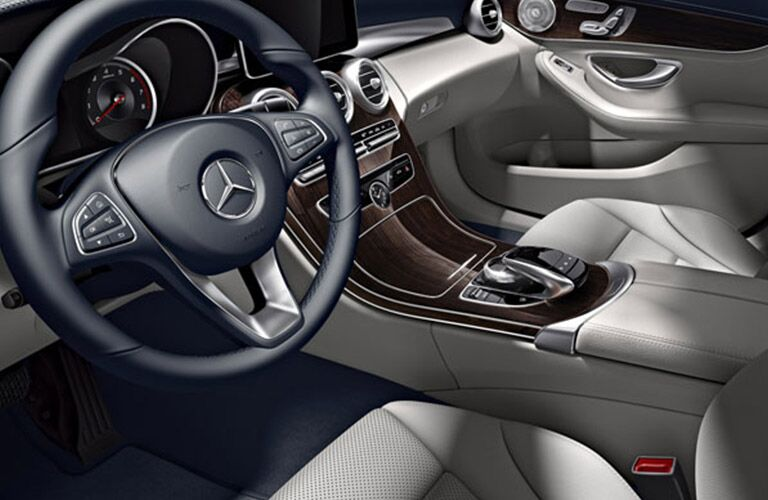 Steering wheel controls and center console of the 2018 Mercedes-Benz C-Class