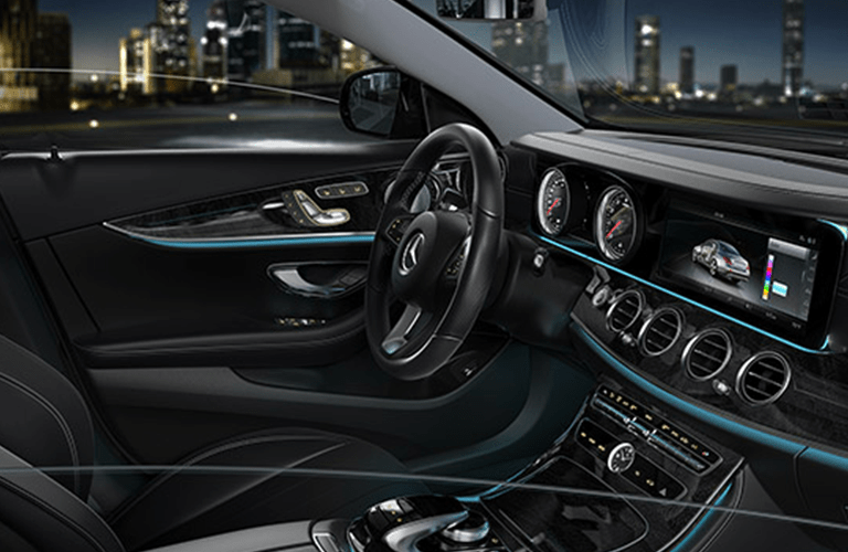 2018 Mercedes-Benz E-Class interior front cabin steering wheel and dashboard with city in window background