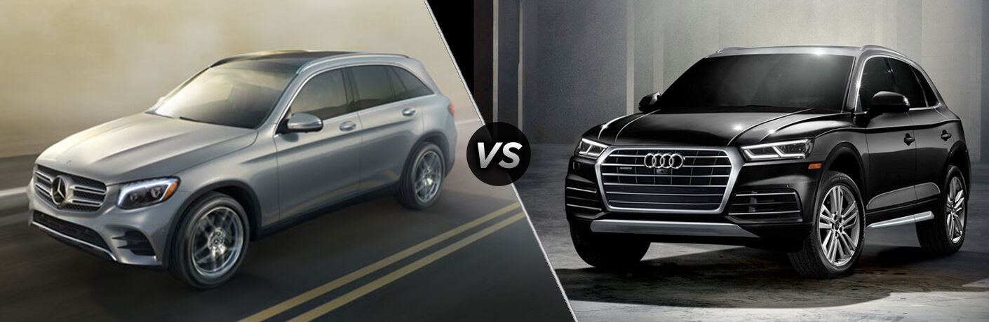 "Driver side exterior view of a gray 2018 Mercedes-Benz GLC SUV on the left ""vs"" front exterior view of a black 2018 Audi Q5"