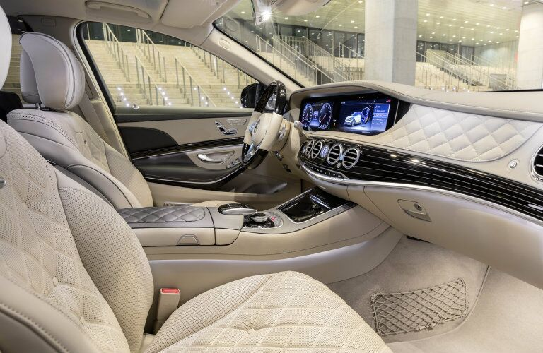 2018 Mercedes-Benz S-Class sedan interior front cabin side view seats steering wheel and dashboard parked in front of building