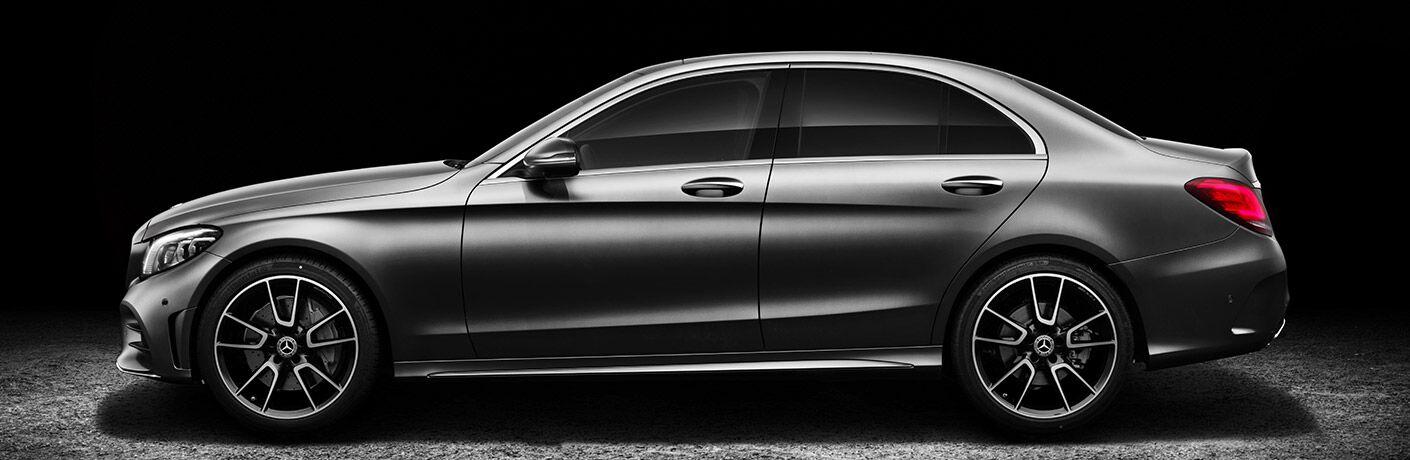 Driver side exterior view of a gray 2019 Mercedes-Benz C-Class Sedan