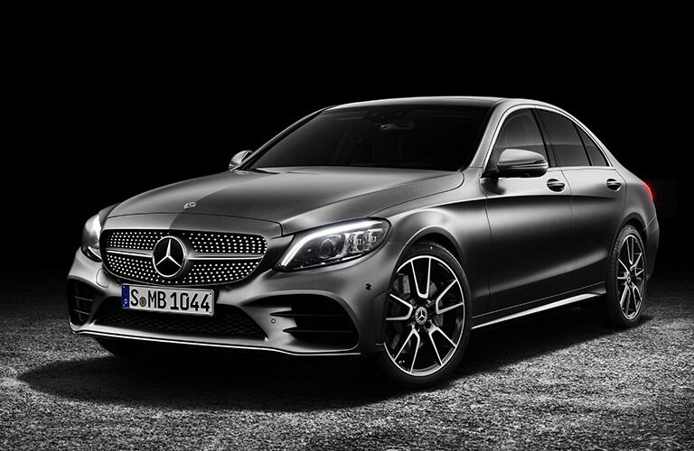 Front driver side exterior view of a gray 2019 Mercedes-Benz C-Class Sedan
