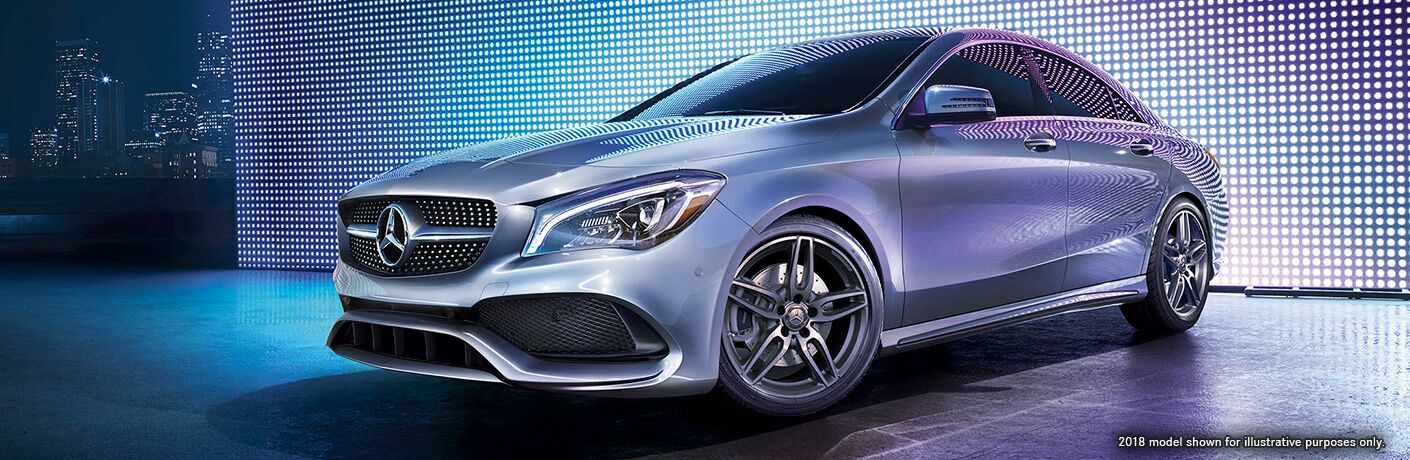 Driver side exterior view of a gray 2019 Mercedes-Benz CLA Coupe