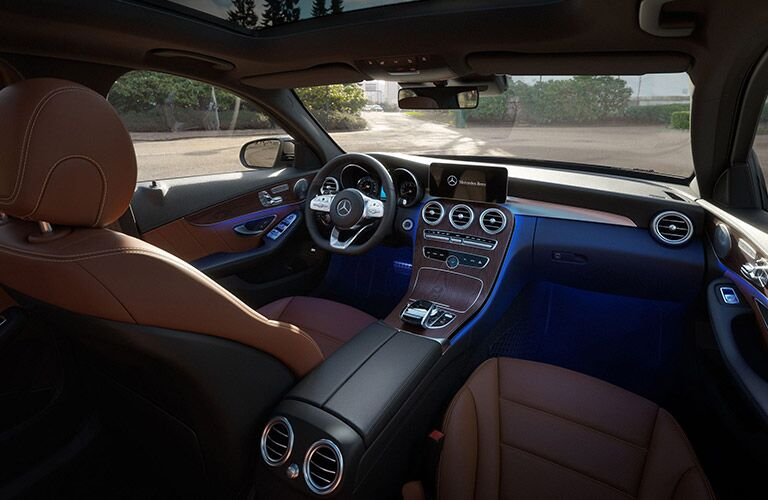 brown front seats and dash of mercedes-benz c class