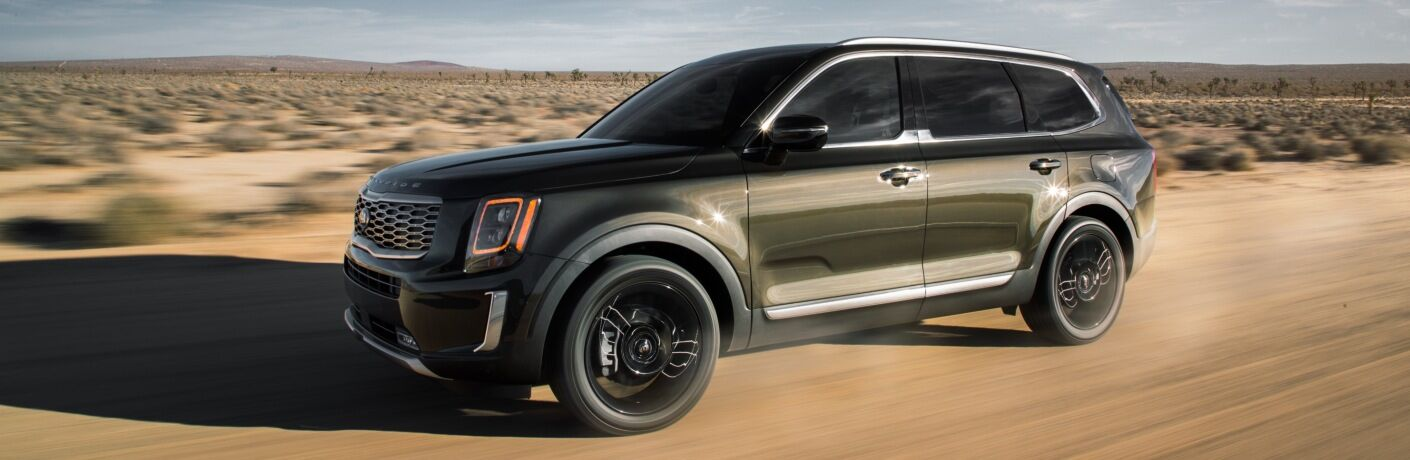 2020 Kia Telluride green in the sand side front view