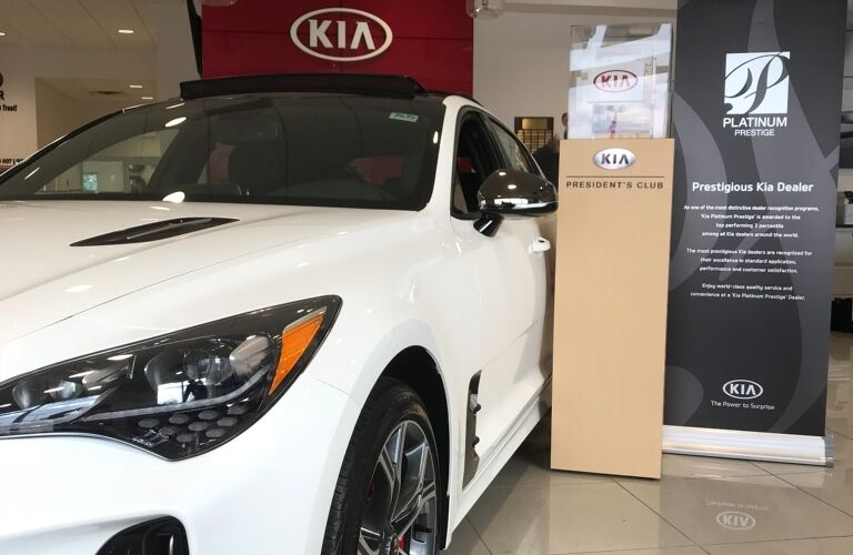 Kia VaDevere awards with white Kia Optima on left