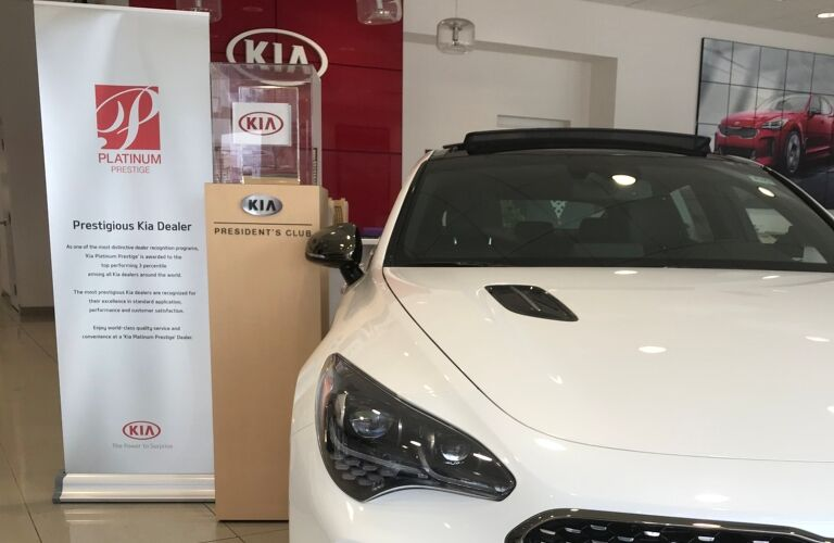 Kia VaDevere awards with white Kia Optima on right
