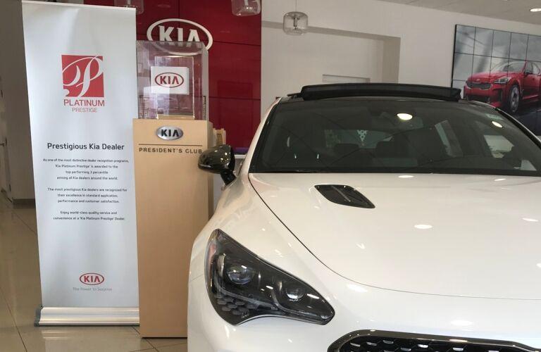 Kia VaDevere awards with white Kia Optima on right