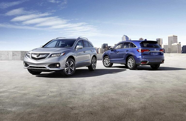 silver and blue 2017 acura rdx on cement