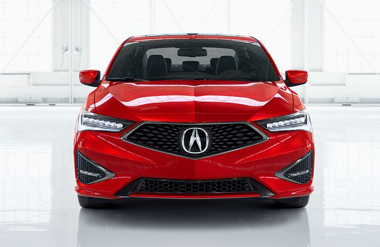 Front headlights and grille of red 2019 Acura ILX