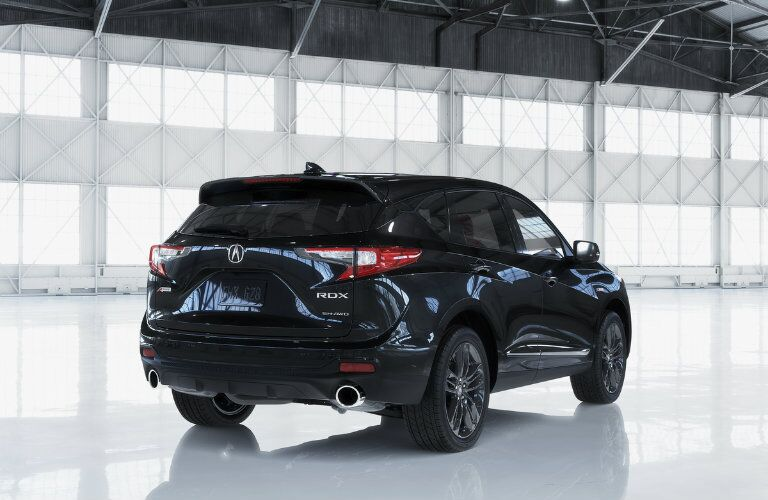 Rear shot of blue 2019 Acura RDX parked inside warehouse