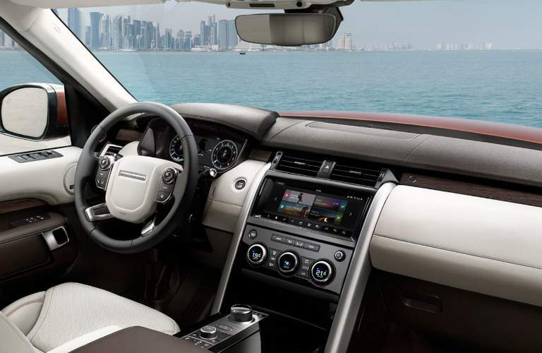 interior of Land Rover Discovery looking out at ocean with dashboard visible