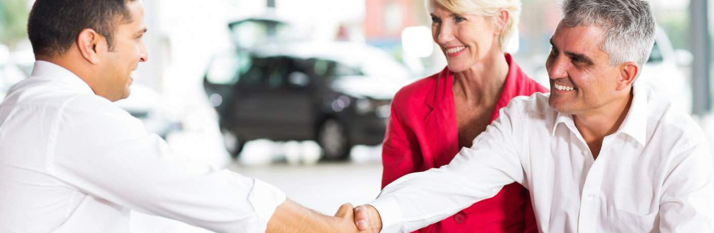 Dealership sales professional working with a couple