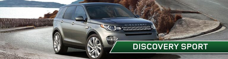 Land Rover Discovery Sport on curvy mountain road with Discovery Sport text overlay