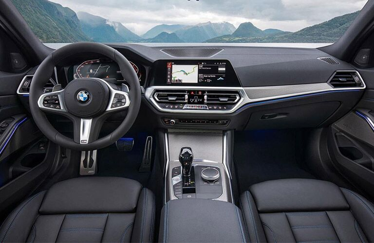 Dashboard and black front seats in 2019 BMW 3 Series